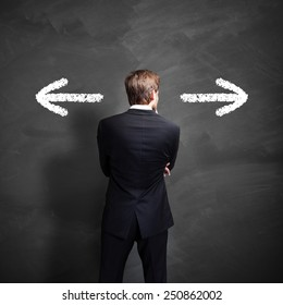 businessman has to decide between two directions