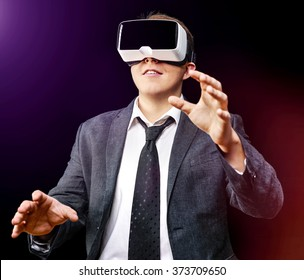 Businessman has fun using his Virtual Reality VR glasses head mounted display