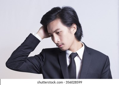 Businessman has Headache: Isolated White Background