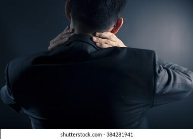 Businessman has neck pain