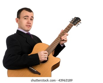 businessman has a rest playing an acoustic guitar