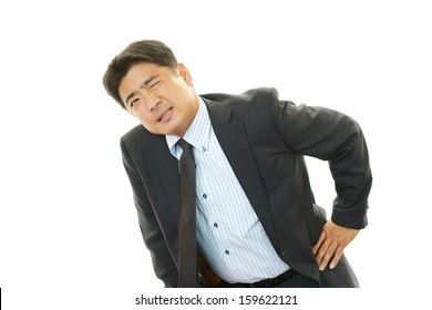 Businessman having back pain