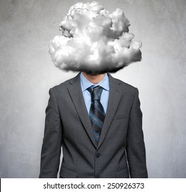 Businessman having his head covered in a cloud