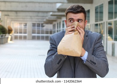Businessman having a panic attack
