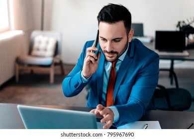 Businessman having phonecall in modern office.