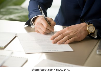 Businessman having signatory right signing contract concept, focus on male hand putting signature on official legal document, entering into commitment, concluding business agreement, close up view