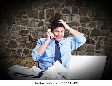 Businessman having a stress. Call phone problem.