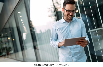 Businessman having tablet and phone at hand