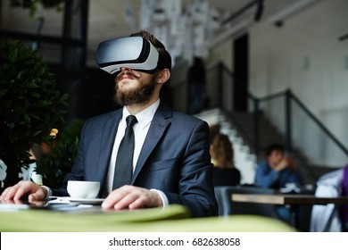 Businessman having virtual experience in cafe