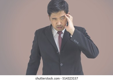 businessman headache in black suit on gradient background with clipping path - can use to display or montage on product