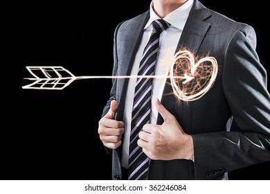 the businessman, heart mark and Arrows