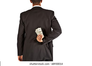 businessman hiding money behind his back