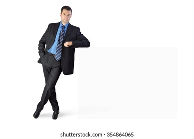 Businessman with his arm leaning on something