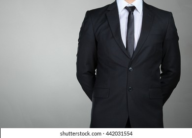 A businessman with his arms crossed