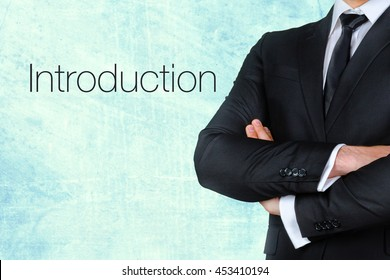 A businessman with his arms crossed near text - introduction