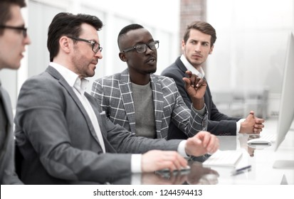 businessman and his business team sitting in the computer room