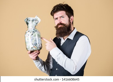 Businessman with his dollar savings. Richness and wellbeing. Security and cash money savings. Banking concept. Man bearded guy hold jar full of cash savings. Establish your budget. Financial success.
