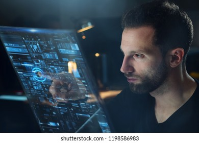 A businessman in his office reads financial news about the world economy on his futuristic newspaper in holography.