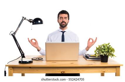 Businessman in his office in zen position