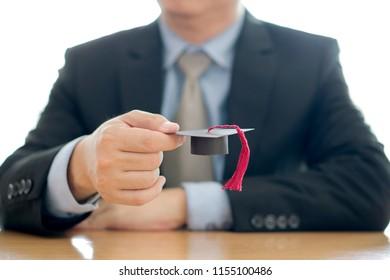 Businessman hold cap eudcation, concept