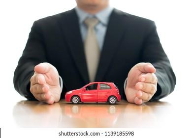 Businessman hold a car