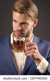 Businessman hold coffee or tea cup, hot drink. Man with glass mug in hand, morning. Coffee mood, coffee recipe. Morning, breakfast, break. Beverage, hot drink