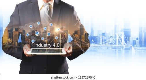 Businessman hold the Industry 4.0 hologram on tablet, Business and Technology, Internet of thinks and network the concept of cryptocurrency, Industry 4.0 concept