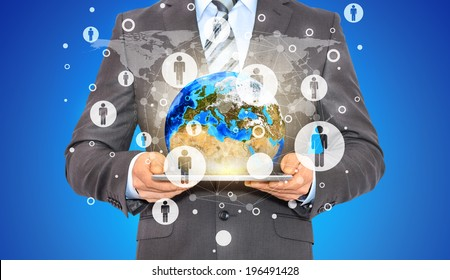Businessman hold tablet pc, Earth and contacts. Elements of this image are furnished by NASA