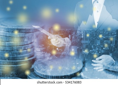 businessman hold tablet pc on money coin and city background. Doueble esposure image