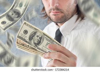 Businessman hold US dollars and money raining from the sky. Paying with USA currency.