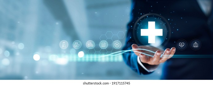 Businessman hold virtual medical network connection icons. Covid-19 pandemic develop people awareness and spread attention on their healthcare, rising growth in hospital and health insurance business. - Shutterstock ID 1917115745