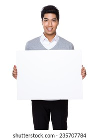 Businessman hold with white board