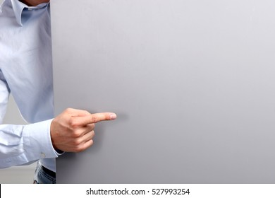 Businessman hold with white card board