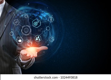 Businessman holding abstract business interface on dark background with copy space. Innovation and finance concept. 3D Rendering