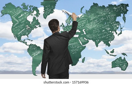 businessman holding airplane  drawing world map