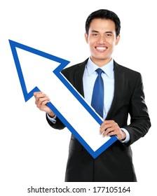 Businessman holding arrow up on white background