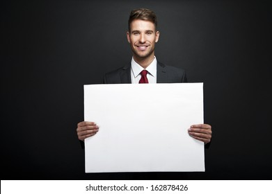 businessman holding banner with copy space