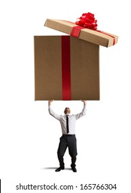 Businessman holding a big present on white background