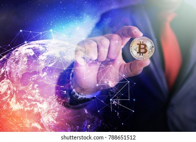 Businessman holding Bitcoin with Global network internet Concept. ,Financial and golden Bitcoin.