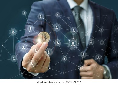 Businessman is holding a bitcoin as part of a business network on blue background.