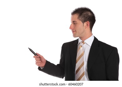 Businessman holding a black marker and pointing to the side. Extra copy space. All isolated on white background.