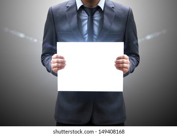 Businessman holding blank