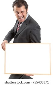 Businessman holding blank board in front of white background