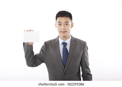businessman holding up blank paper