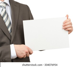 Businessman holding blank paper on isolated white background