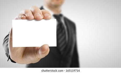 businessman holding blank paper visit card