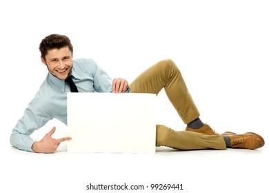 Businessman holding blank poster