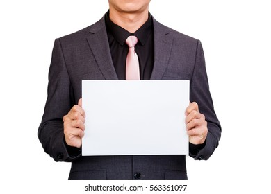 Businessman holding blank sign paper in hands