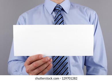 Businessman holding a blank sign ready for message