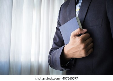 A businessman holding a book